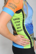 Load image into Gallery viewer, Side view of A woman wearing the short sleeve Wild Atlantic Bike Kerry Short Sleeve Cycling Jersey. The text reads Donegal, Leitrim, Sligo, Mayo, Galway