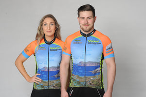 A man and a woman wearing the short sleeve Wild Atlantic Bike Kerry Cycling Jersey