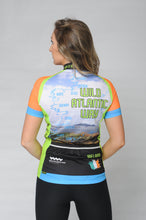 Load image into Gallery viewer, Back view of a woman wearing the short sleeve Wild Atlantic Bike Kerry Short Sleeve Cycling Jersey