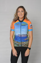 Load image into Gallery viewer, A woman wearing the short sleeve Wild Atlantic Bike Kerry Short Sleeve Cycling Jersey