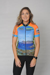 A woman wearing the short sleeve Wild Atlantic Bike Kerry Short Sleeve Cycling Jersey