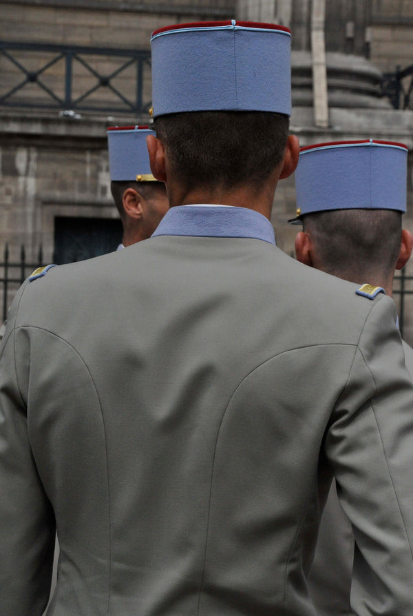Ross Watson photograph of French soldier in blue cap with grey jacket viewed from behind