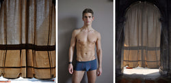 Ross Watson triptych photograph with portriat of underwear clad man in centre and hessian curtains either side.
