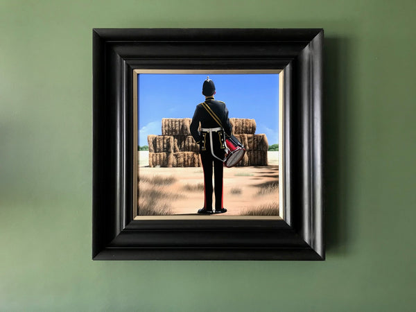 Ross Watson original oil painting of a British military drummer viewed from behind standing in front of a rural Australian haystack framed in an Italianate black frame on a green wall