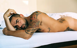 Ross Watson photograph of naked Marco Da Silva lying on bed