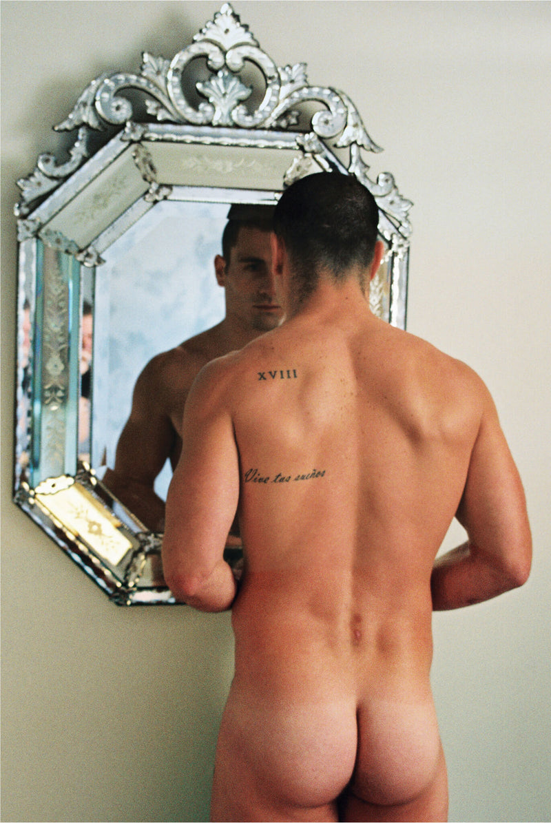 Ross Watson photograph of rear view of naked Paul Licuria standing in front of venetian mirror.