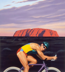 Male Cylist in front of Uluru