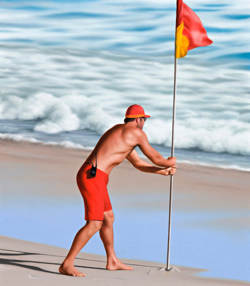 Ross Watson painting of lifesaver placing red and yellow flag into sand at the beach