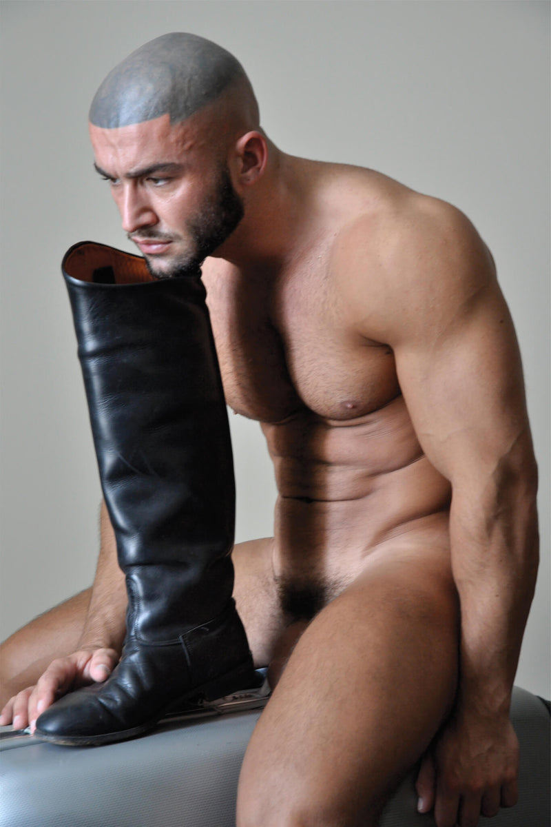 Ross Watson photographic portrait of Francois Sagat naked leaning into boot