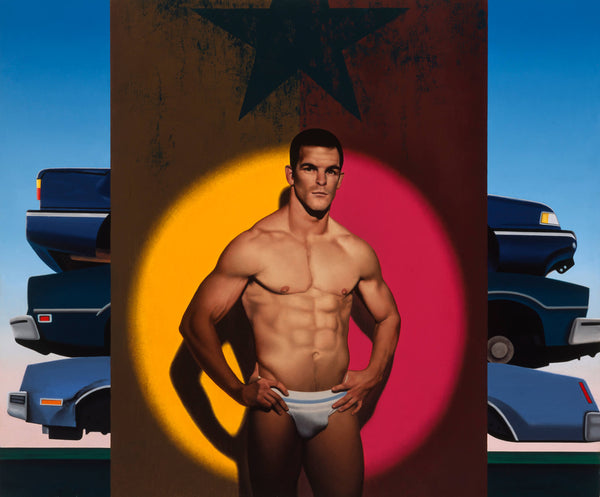 Portrait of Ian Roberts wearing a jock strap in spot light with orange and purple background and a stack of crushed cars behind