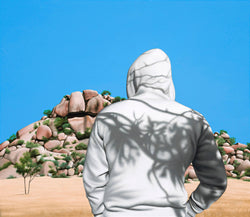 Painting of man in white hoody with shadows of trees on back standing in front of austalian desert rock formation
