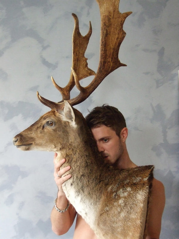 Ross Watson photography of Jake Shears holding a taxidermy deer head