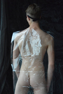 Ross Watson photography of naked man wrapped in plastic viewed from behind