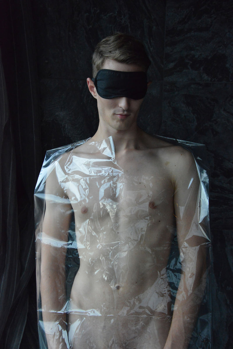 Ross Watson photograph of naked man wrapped in plastic wearing blind fold