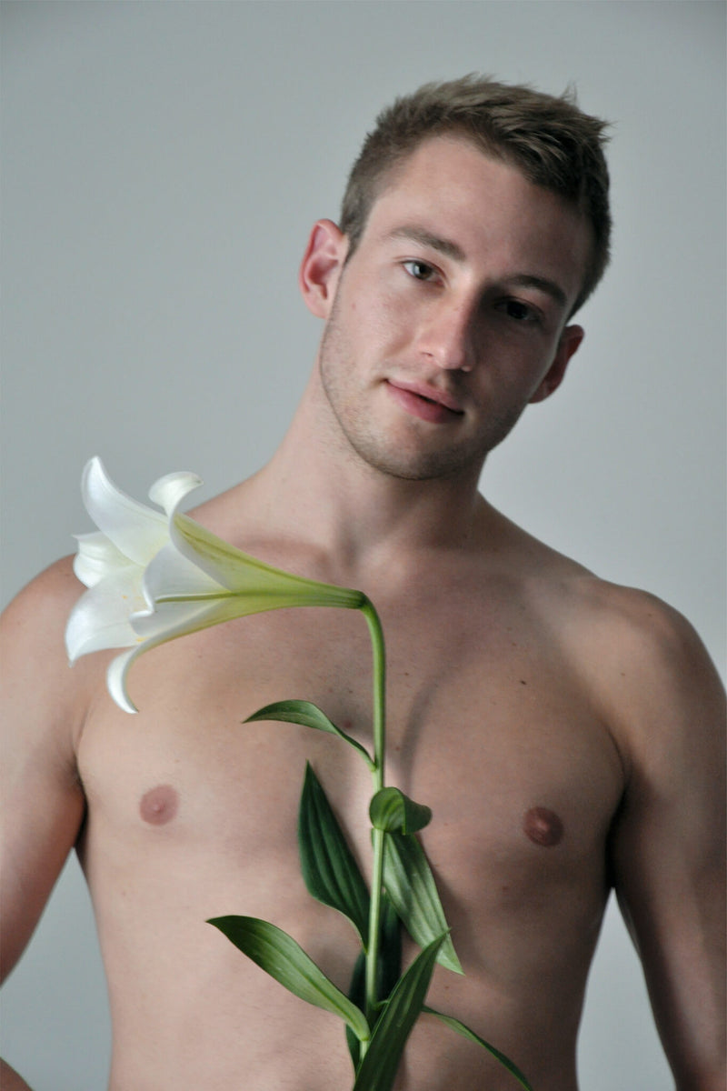 Ross Watson photographic portrait of Matthew Mitcham holding lily
