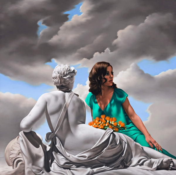 Portait of singer Tina Arena reclining in green dress with orange waratah flowers in her lap behind an ancient marble sculpture of a reclining woman with a stormy sky
