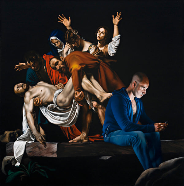 Man in foreground in blue hoody and jeans using phone sitting on stone slab with Caravaggio painting in background depicting the entombment of christ