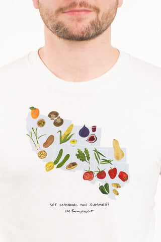 A white t-shirt with a watercolor illustration of seasonal produce in the Southwest