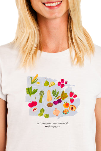 A white t-shirt with a watercolor illustration of seasonal produce in the Midwest