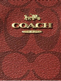 Coach Large Corner Zip Wristlet In Signature Canvas In 1941 Red