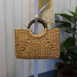 tan gorgeous light weight woven straw rattan bag