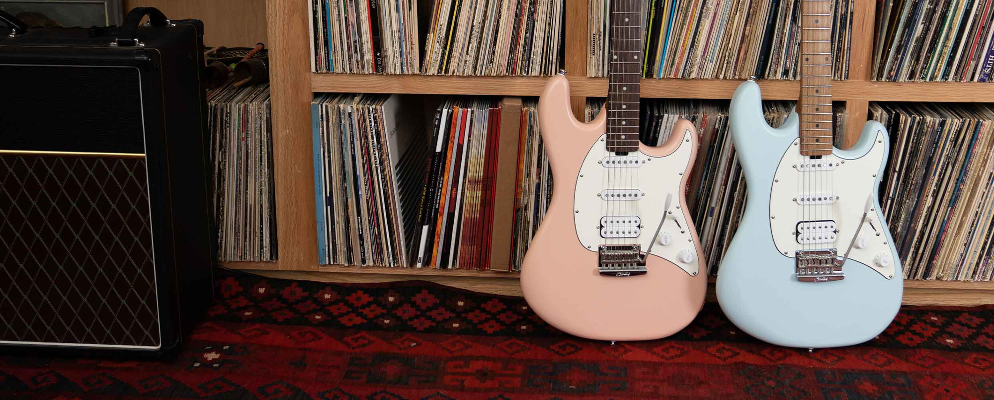 The Cutlass CT50 guitar in Vintage Sunburst resting against a vintage amps.