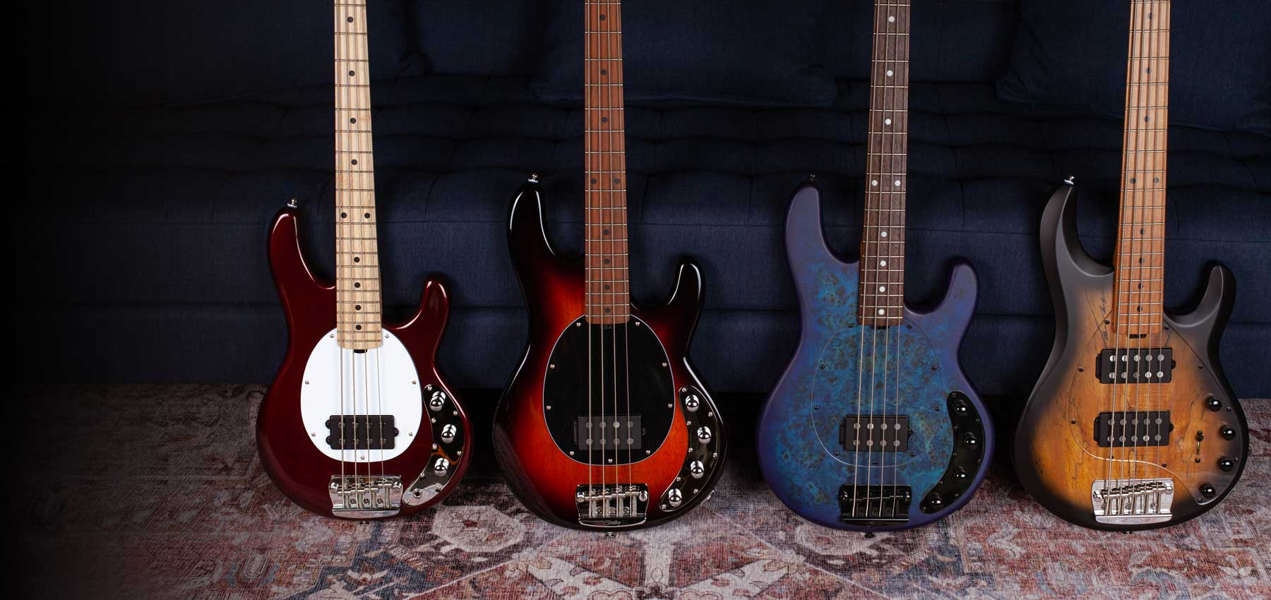 The StingRay Bass collection resting against a sofa.