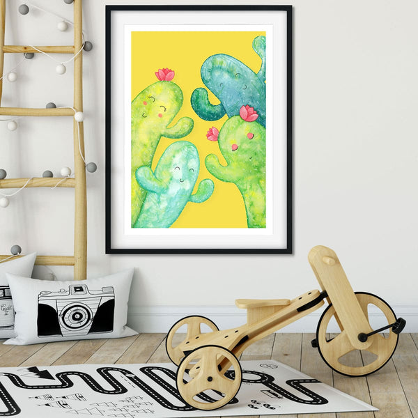 Cute cactus family wall art in a kids bedroom.