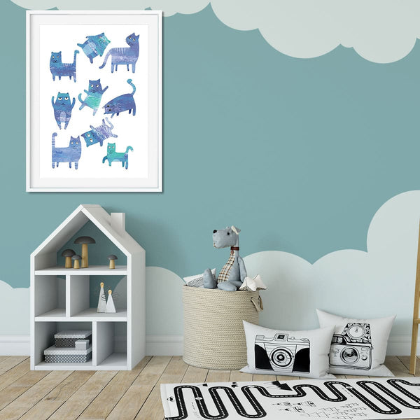 Kids bedroom with wall art of silly blue cats.