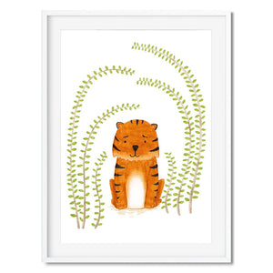 Wall art of a cute baby tiger in some bushes.