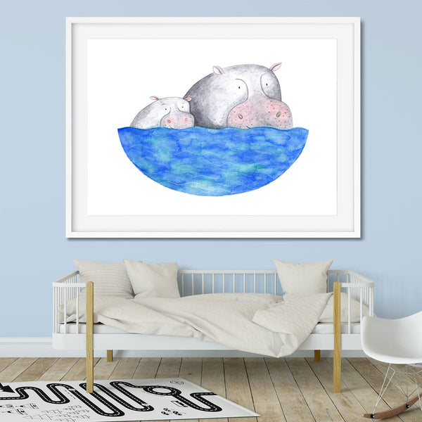 A kids bedroom with a print of a hippo family on the wall.