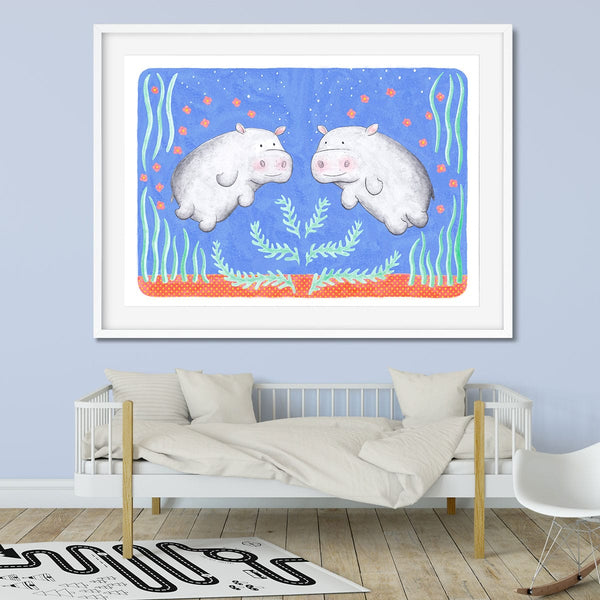 Wall art of two underwater hippos in this safari themed bedroom.