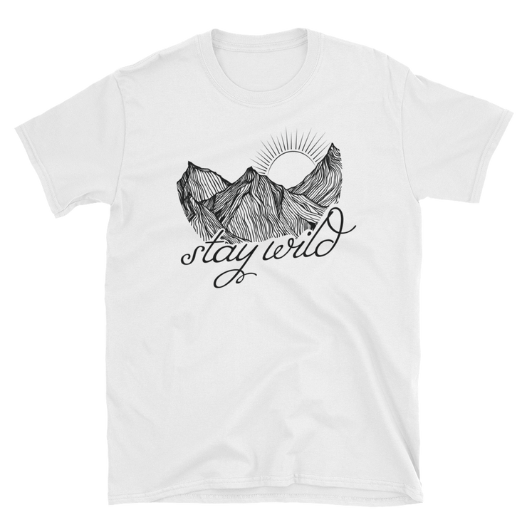 "white t-shirt, with mountain illustration, that reads ""Stay Wild"" in a handdrawn script."