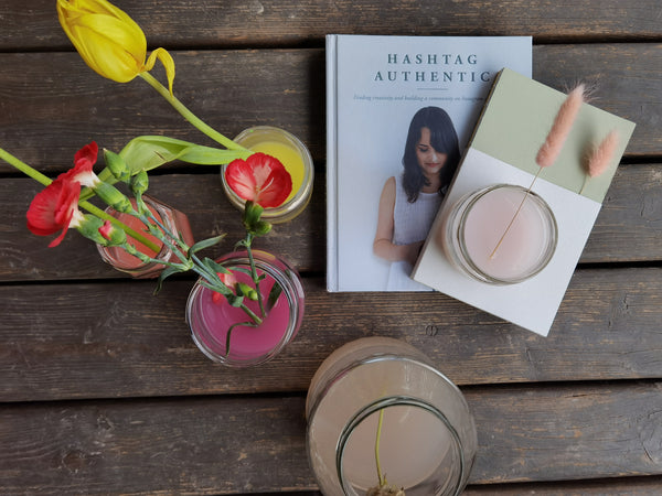 hashtag authentic book. notebook made from sustainable paper. flowers in colored water.