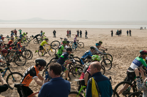 riders setting off racing at battle on the beach