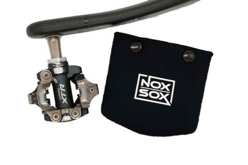 Nox Sox Small Pedal Cover next to a Shimano XTR Clipless Pedal