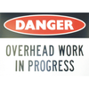 Worker Above Sign