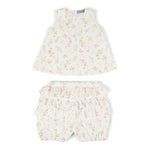 outfit in white organic cotton with floral motifs