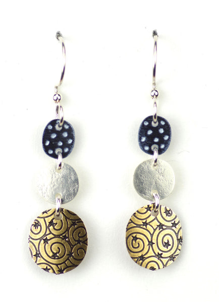 Three part black circle w/ patterned gold part