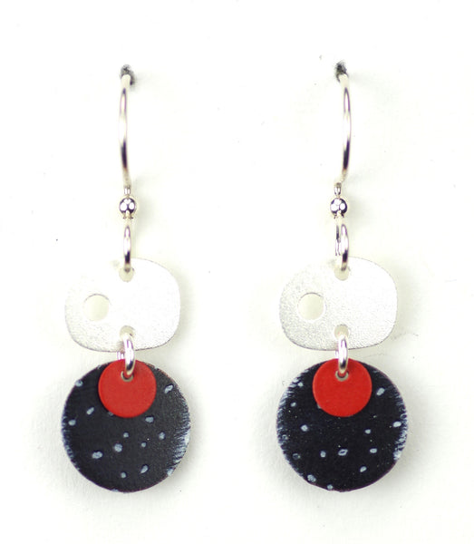Silver oval w/black & red circles