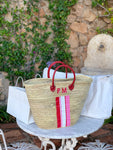 Red handles straw bag