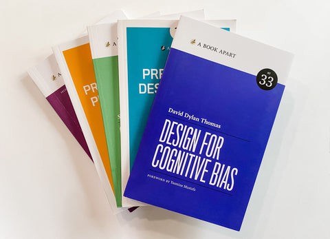 Fan of books with Design for Cognitive Bias on top.