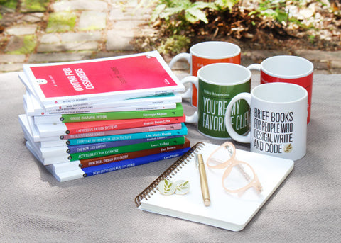 Books, a notepad and mugs.