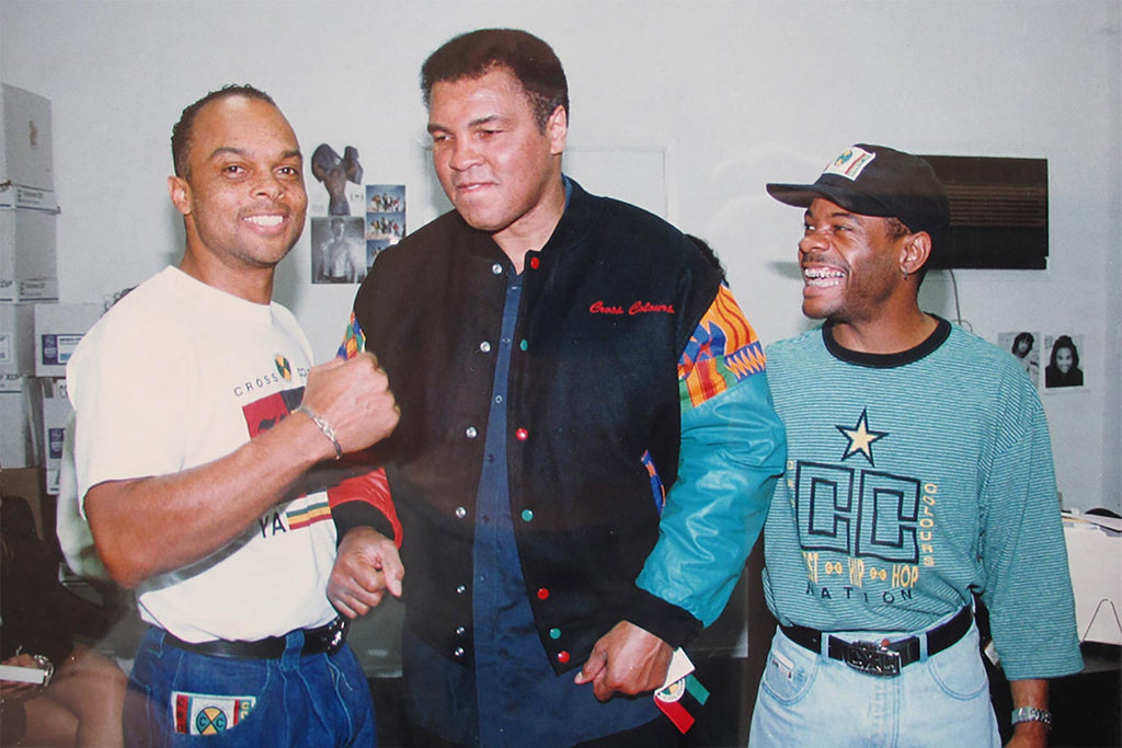Carl Jones and TJ Walker together with Muhammed Ali in Cross Colours