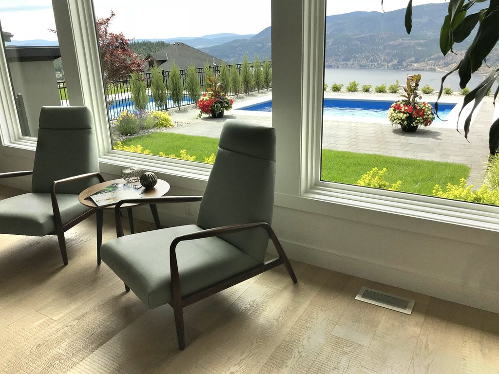 vent covers brushed chrome finish on light oak harwood flooring white walls and window casings wilden builders kelowna showhomes by kulgrilles