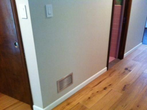 wall vent cover brushed chrome finish vent on light grey wall oak hardwood floor modern homeowner happy customer photos by kulgrilles