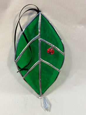 Leaf and lady bug stained glass panel