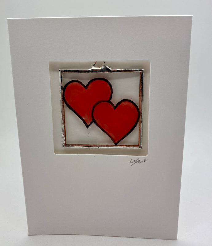 Red heart stained glass greetings card. (LD)