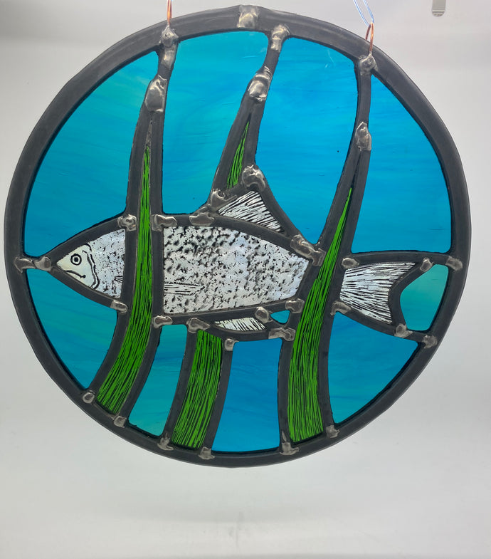 Fish stained glass panel.                                                   LD