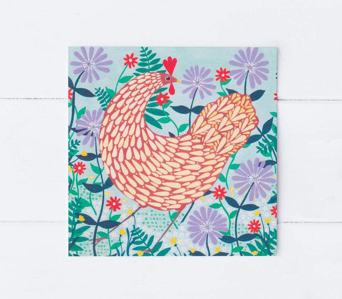 Brown chicken among lilac flowers greetings card